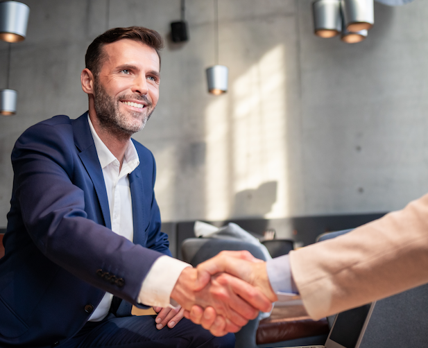 Happy business man shaking hands after crowdfunding